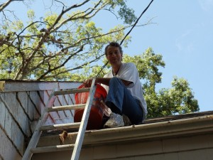 Jeff Frank paints a home for the Fuller Center